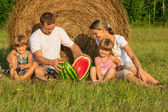 Happy young family on vacation — Stock Photo