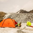 Stock Photo: Climber has rest lying in tent on glacier