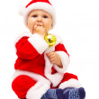 Small Santa with toys and spheres in hands — Stock Photo