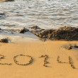 2014 inscription on the sand near sea — Stock Photo