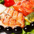 Tasty and appetizing fish grill with olives — Stock Photo