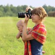 Stock Photo: Mother with the kid on hands photographs