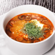 Plate with soup at restaurant on table — Stockfoto