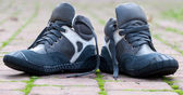 Two children s shoes outside — Stock Photo