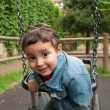 Little cute boy playing on a swing — Foto Stock