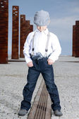 Serious boy with the gun — Stock Photo