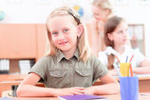 Pupils in classroom — Stock Photo