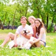 Happy young family with Labrador — Stock Photo #13480183