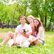 Happy young family with Labrador - Stock Photo