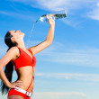 Sport girl in red uniform with bottle of water — Foto Stock #13948669