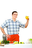 Portrait of a young man, hold bell pepper — Stock Photo