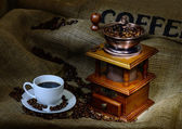 Coffee mill and cup — Stock Photo