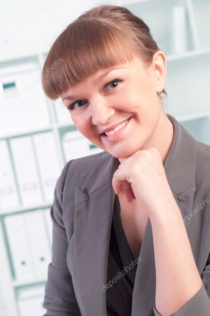 Portrait of a beautiful young woman who works in the office  Stock Photo #15749431