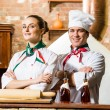Portrait of two cooks - Stock Photo