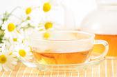 Teacup with herbal chamomile tea — Stock Photo