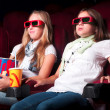Stockfoto: Two young girls watching in cinema