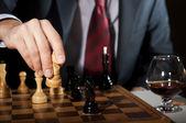 Businessman plays chess — Stock Photo