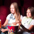 Two young girls watching in cinema — 图库照片 #16259165