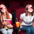 Two young girls watching in cinema — 图库照片 #16259811