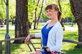 Portrait of a beautiful woman in summer park — Stock Photo