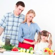 Stock Photo: Portrait of family cook together