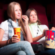 Two girls in the cinema — Stock Photo