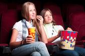 Two girls in the cinema — Stock fotografie