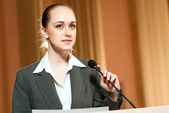 Female speaker — Stock Photo