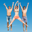 Stock Photo: Young friends jumping