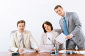 Group of business discussing documents — Stock Photo