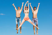 Young friends jumping — Stock Photo