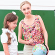 Stockfoto: Teacher explains lesson in geography