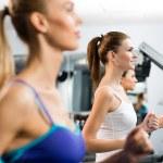 Women running on a treadmill — Stock Photo