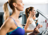 Women running on a treadmill — Stock Photo