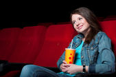 Woman in cinema — Stock Photo