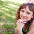 Pretty girl in park on ground — Stock Photo #18003879