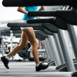 Womrunning on treadmill — Stock Photo #18003957