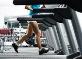 Woman running on a treadmill — Stock Photo