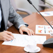 Stock Photo: Businessman writing on paper notes