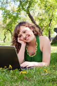 Woman, working with a laptop — Stockfoto