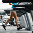 Woman running on a treadmill — Stock Photo #18180495