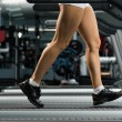 Woman running on a treadmill — Stock Photo #18315343