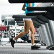 Woman running on a treadmill — Stock Photo #18355335