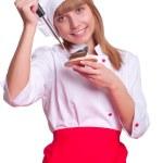 mulher atraente cozinheiro um over branco fundo — Foto Stock