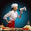 Asian female chef shouting into a megaphone — Stock Photo