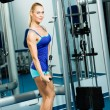 Stock Photo: Young woman doing body-building in the Gym
