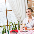 Stock Photo: Portrait of nice lady in restaurant