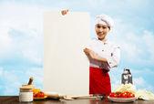 Chef femme tenant une affiche pour texte — Photo