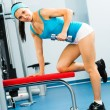 Female athlete dumbbell - Stock Photo