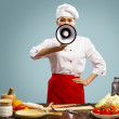 Asian female chef holds a megaphone — Stock Photo